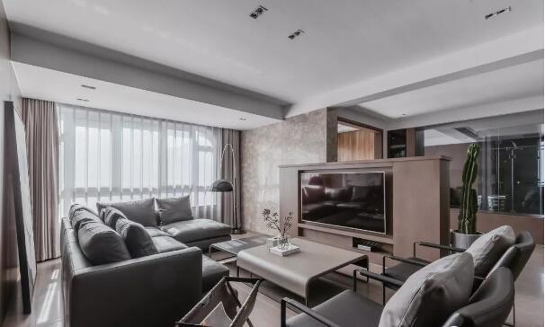 定制半高电视柜搭配石纹背景墙,同时作为客厅与休闲区的隔断,也不影响图片